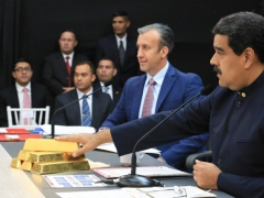 President Maduro, accompanied by his industries minister, Tareck El Aissami, highlights the importance of gold upon unveiling the Petro Gold cryptocurrency in March